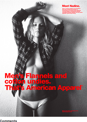 A woman with no pants on wearing american apparel flannel