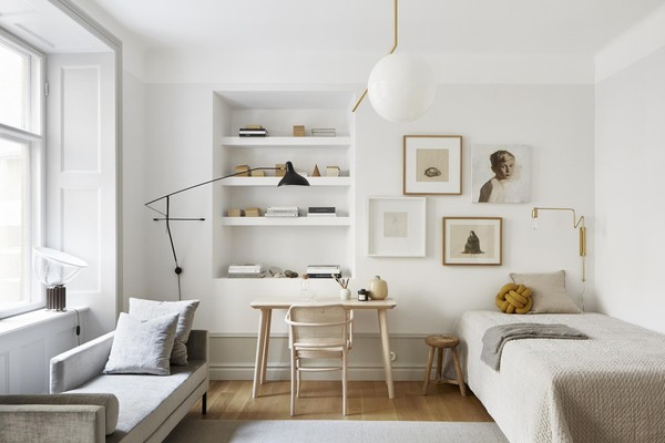 Natural organic and serene neutral Scandinavian modern bedroom decor in a Stockholm apartment