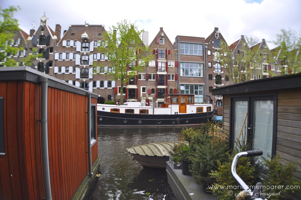 houseboats, houses and canals in Amsterdam, Netherlands
