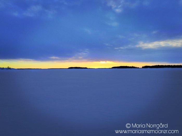 sunset on frozen sea Finland