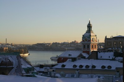 View of rooftops in Stockholm, in January, full of snow