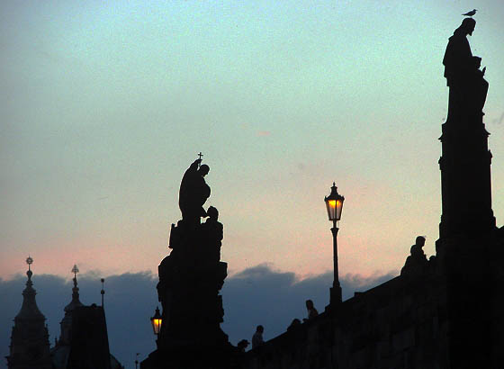 Charles Bridge silhouettes against evening light