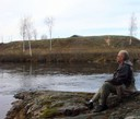 Pondering the silent autumn river