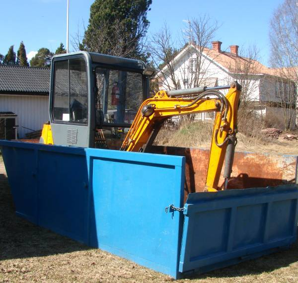 Mini excavator in container