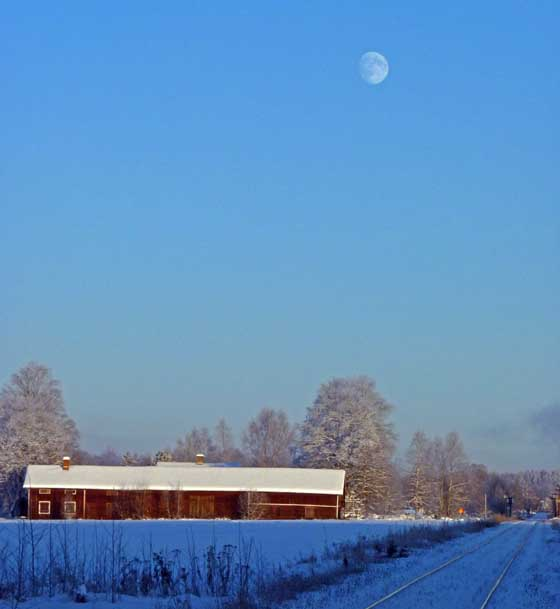 Railroad, farmhouse and moon